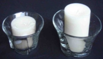 Different sized candles in their holders